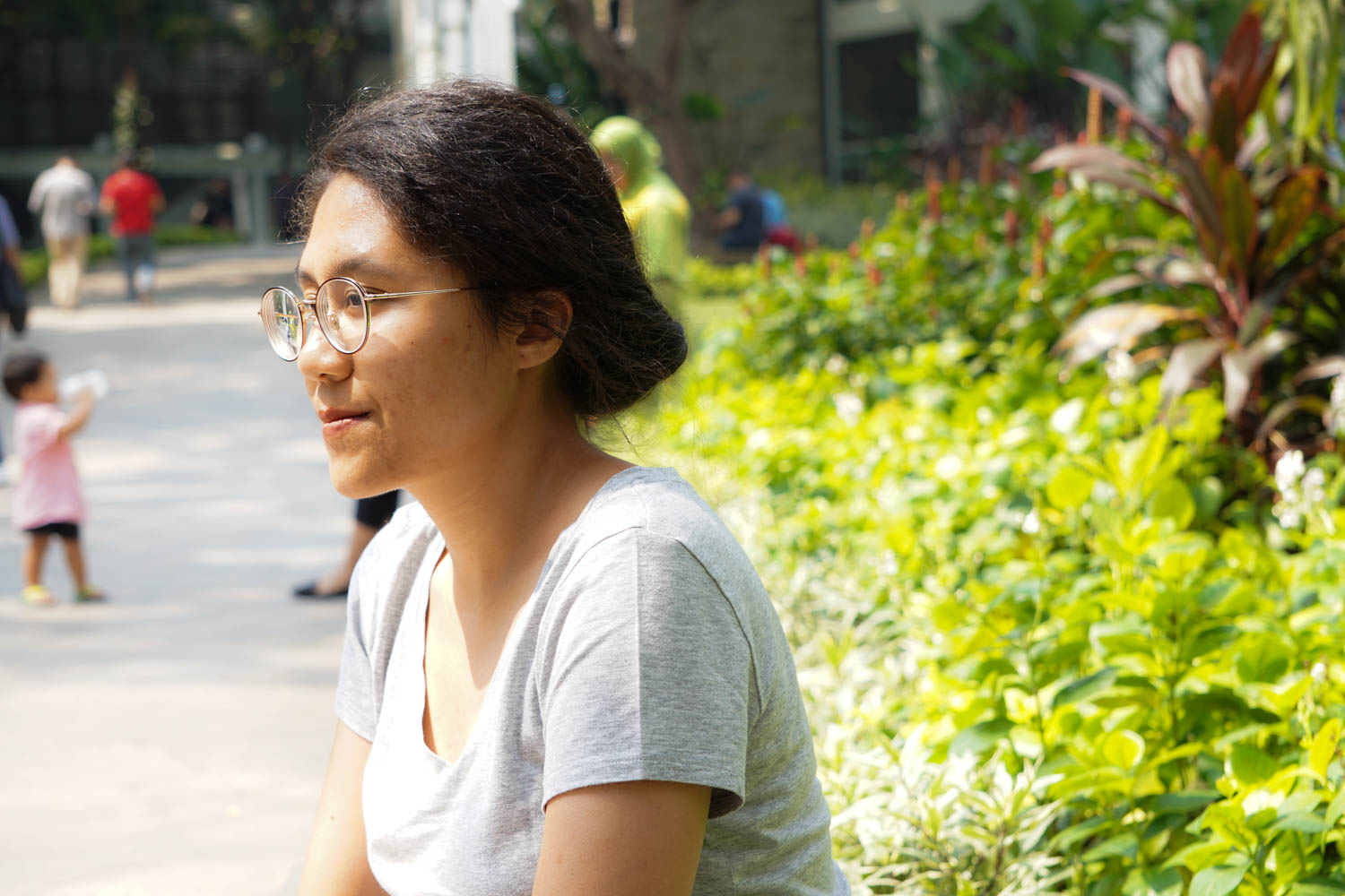 Indonesian women in a bun looking into the distance