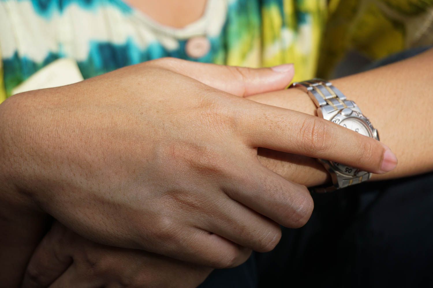 hand covering a watch