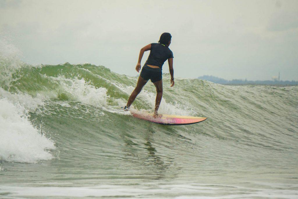 Malaysian girl surfing in Malaysia.